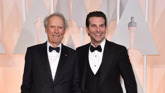 Clint Eastwood and Bradley Cooper at 2015 Academy Awards. wwwmytributejournal.com