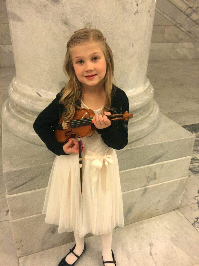 Makena playing her violin.