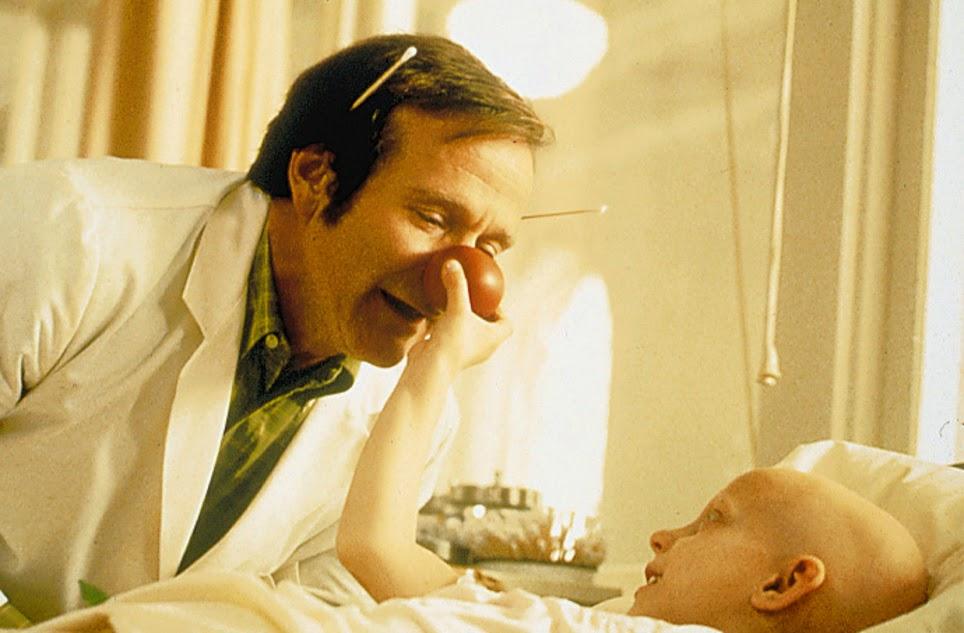 Robin Williams as Patch Adams.